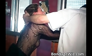 Tied brunette gets spanked and dildo