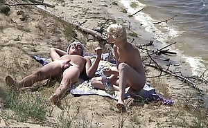 Nudists fuck on the littoral