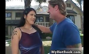 Solara Star sits outdoors holding her husbands ha