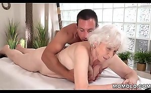 Old mother Norma enjoys intercourse after massage