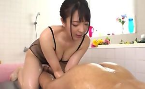 Hot Japanese girl with beamy natural tits licks BF's asshole