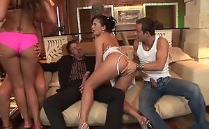 Four lusty harlots getting their expectant holes fucked