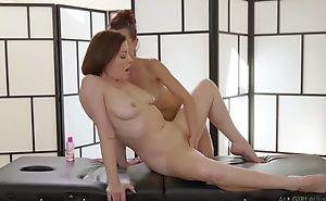 Two gormandizing lesbian babes licking passionately during a massage