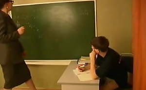 Russian teacher with hammer away addition of boy