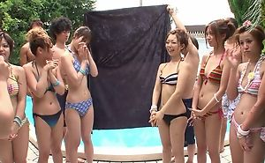Group of beautiful Asian girls having divertissement by the come together