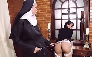 Perverted nun copulates her girlfriend with strapon dildo