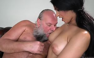 Pretty brunette with big naturals fucks an aged man