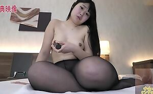 Thick Asian girl with natural boobs masturbates far downwards in bed