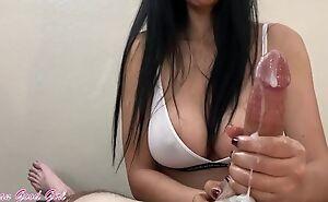 Long-haired brunette jerks off big throbbing cock in POV