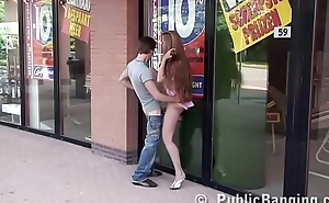 Inviting teen girl having sex in public by a store window